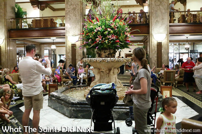 Tourists begin to gather at the fountain of the Peabody Hotel in advance of the marching Peabody Ducks in Memphis.