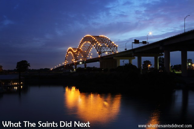 "The bridge is named for 16th century Spanish explorer Hernando de Soto who explored this stretch of the Mississippi River, and died south of Memphis. At night, the bridge is illuminated by 200 sodium vapor lights along its ""M"" structure. The big ""M"" on the bridge has become a symbol of the city."