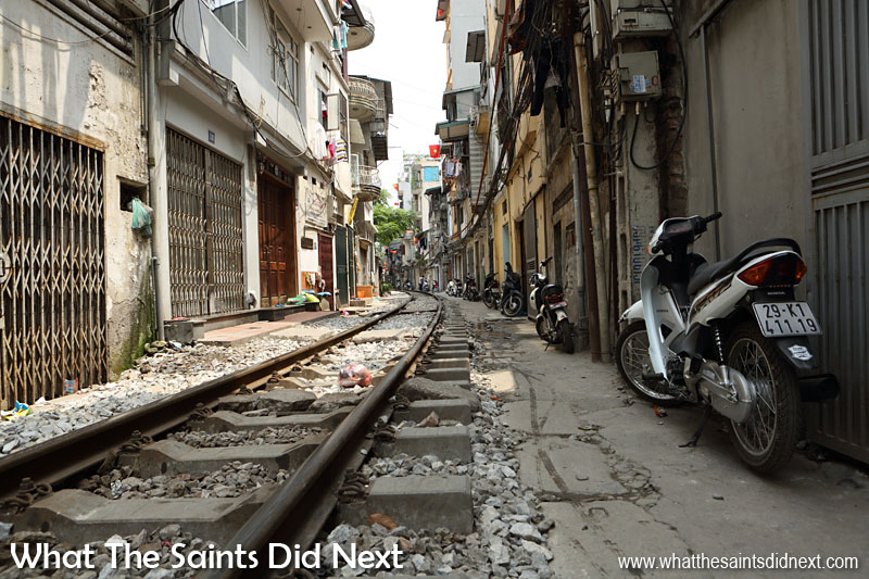 Mopeds must be parked carefully, no room for getting it wrong! Train track running through the narrow Train Street in Hanoi.