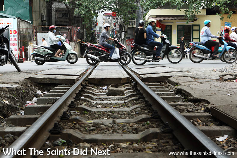 The relentless Hanoi moped traffic will give way to the train, but then continues immediately once it's passed.