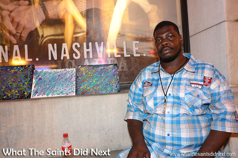 Nashville artist, James, selling some of his paintings on Broadway.