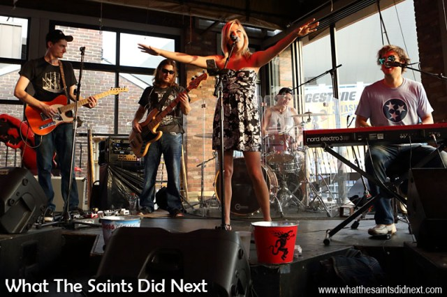 """The band really was country, don't be fooled by the rock styling. Great music to get our night started, including the hit of the moment, """"Girl Crush"""" by Little Big Town. Note the 'tips' bucket at the front of the stage. A Night Out In The Nashville Honky Tonks."""