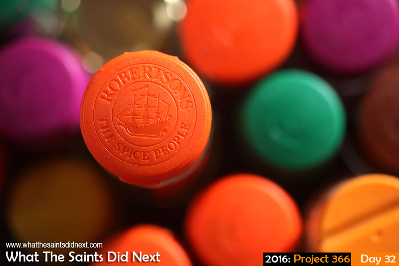 'Stand tall'<br /> 1 Feb 2016, 17:06 - 1/125, f/3.2, ISO-100 + flash<br /> Robertsons colourful spice bottle tops.
