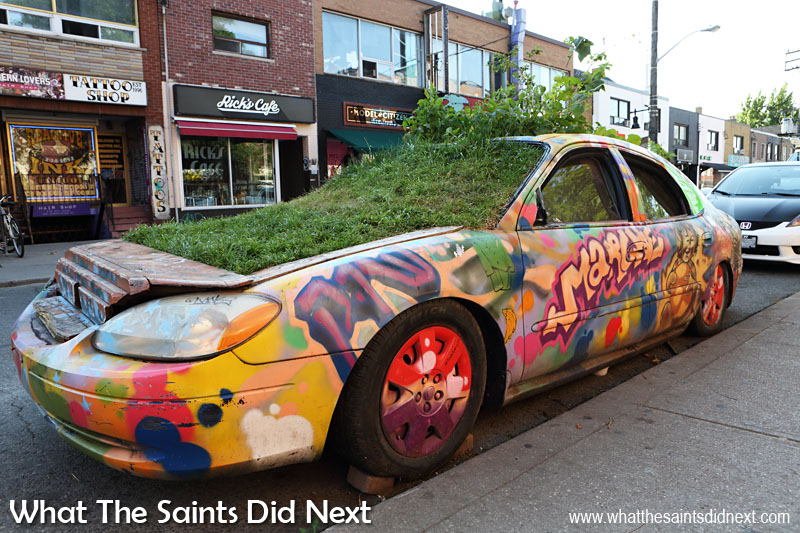 The 'garden car' was formally a 2001 Ford Taurus and has been a feature of the Graffiti Street Art of Toronto for around 10 years. Green car is part of the Community Vehicular Reclamation Project and is the product of Rock & Adrian Hayles Productions.com.