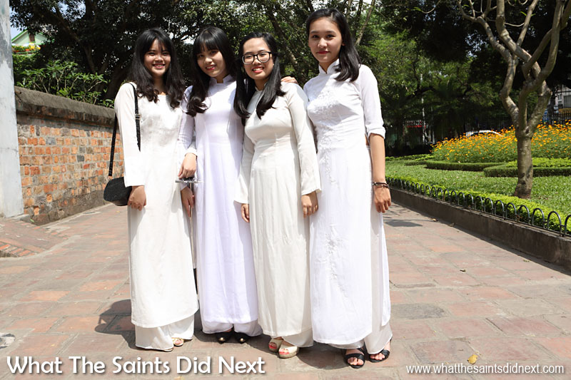 These girls dressed in matching white traditional costume kindly allowed to take a photo.
