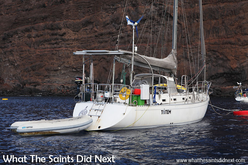 Yacht Totem moored in James Bay, St Helena. Some information for boat buffs about Totem, a type Stevens 47 yacht. Overall length 46′-10″, load waterline length 37′-9″, Beam 14′-3″, Draft 6′-0″, Displacement 32,000 lbs, Ballast 14,500 lbs, Sail Area 1,051 sq ft. #sailingtotem