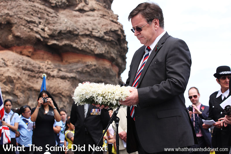 At the annual Remembrance Day Service on St Helena, held each year on the sea front. Governor Mark Capes laying one of the wreaths on the Cenotaph. 11 November, 2012.  The Governor of St Helena Mark Capes.