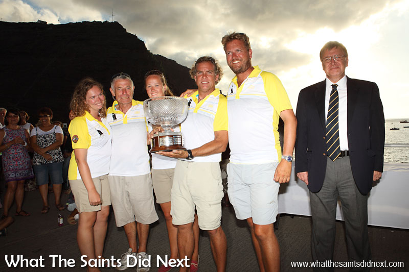 The winning crew of the yacht, Black Cat, in the Cape Town to St Helena, Governor's Cup Yacht Race, holding the large trophy just presented to them by Governor Mark Capes at the Jamestown wharf. 14 January, 2015.  Governor Of St Helena Mark Capes.