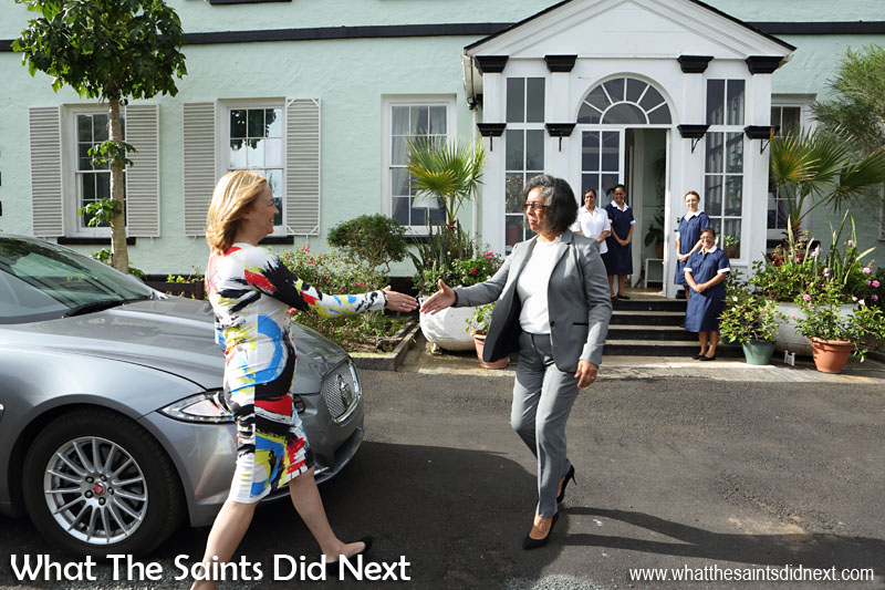 Earlier in the day - Her Excellency the Governor Designate, Ms Lisa Phillips, arriving for the first time at Plantation House, being met by Manager of the Governor's Office, Sandra Sim and staff at Plantation.
