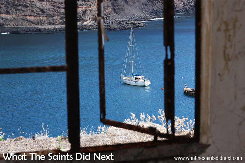16 Pictures Celebrating St Helena Day 2016. A dreamy view of a yacht anchored in James Bay, photographed from inside part of the ruin at Mundens.
