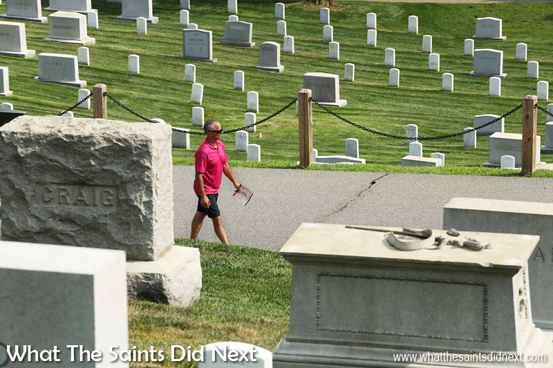 A visitor strolling through Arlington Cemetery.