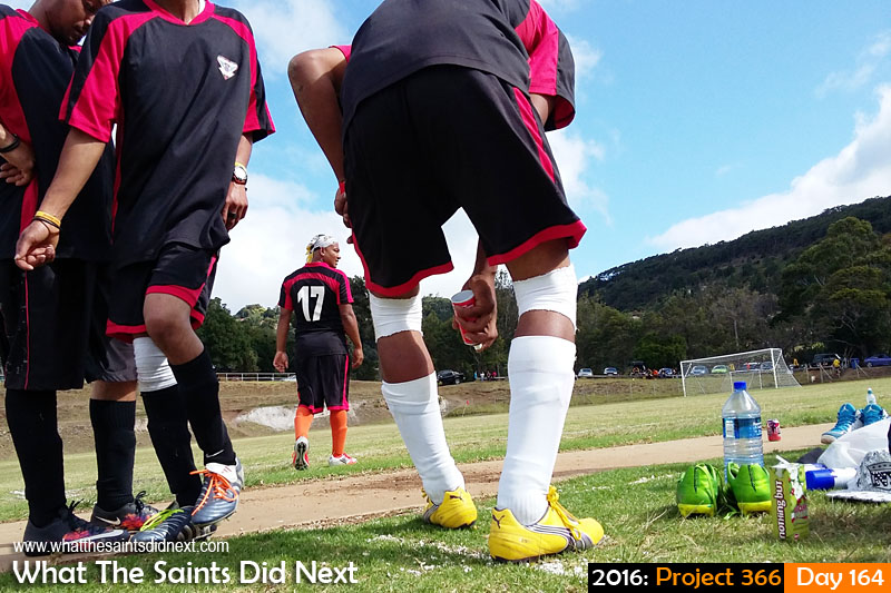 'Orlando Pulse'<br /> 12 June, 2016, 14:37 - 1/760, f/2.4, ISO-50 - Samsung Galaxy A3<br /> Refugees football player applying muscle heat spray to sore joints at half time.