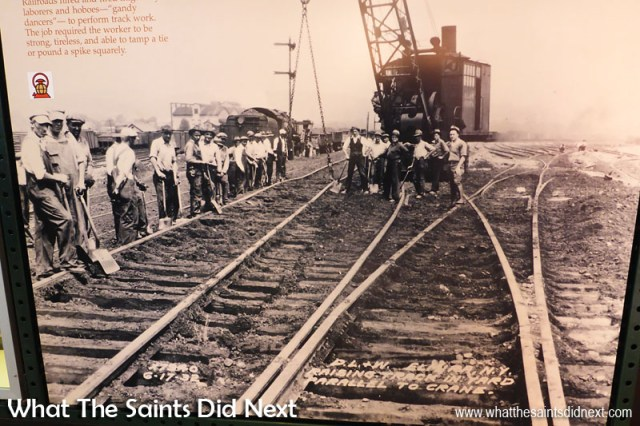 """""""Track workers were required to be strong, tireless, and be able to tamp a tie or pound a spike squarely. Photo dated: 6-17-32."""" Text written on picture reads: """"Raising track in yard parallel to crane."""""""