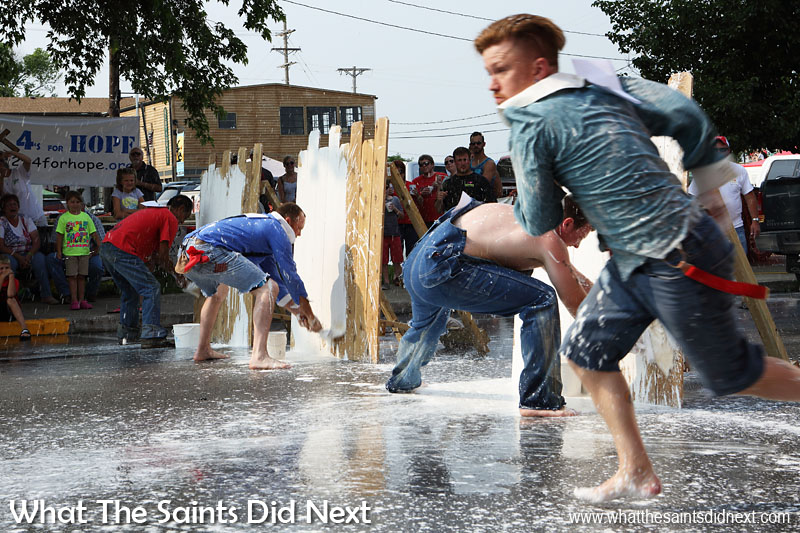Another July Fourth, Independence Day tradition in Hannibal, Missouri, is the 'Tom Sawyer Day' fence painting competition which takes place near the mud volleyball, along the banks of the Mississippi River. Competitors run to their 'fence,' which they cover in whitewash as fast as possible before dashing back to the finish line.
