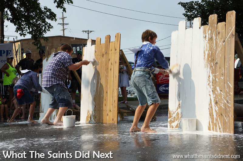 Another set of 'Toms' get racing to paint their fence first. Fence painting in Hannibal, Missouri, for 'Tom Sawyer Day' is a popular event every July Fourth.