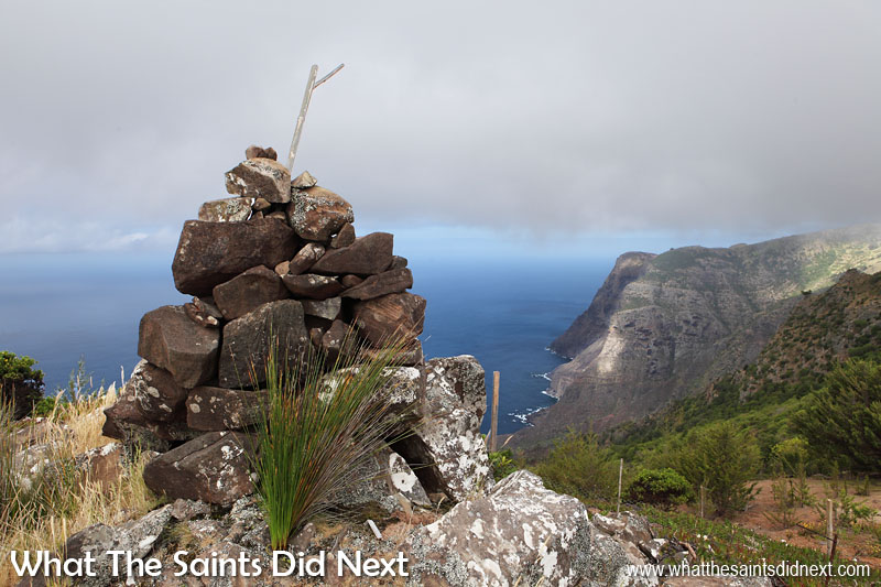 One of the cairns that mark the route. In the distance is Man and Horse point. Blue Point post box walk, St Helena Island.