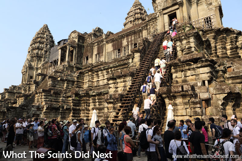 Visiting the historic Angkor Wat temples in Cambodia. Accessibility is very limited at this major tourism site for anyone not able to negotiate the ancient stone walkways and steep stairs on their own. World Tourism Day 2016 - Tourism for All