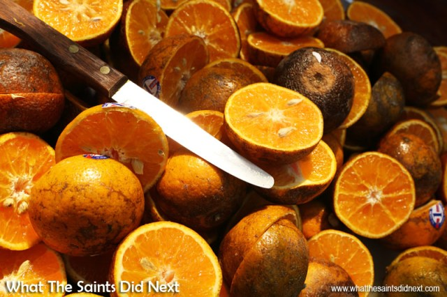 How To Make Better Use of Colour In Photography - A street vendor in Thailand selling freshly squeezed orange juice had his fruit already cut in half and ready for thirsty customers. The rich colour was too tempting in the midday sun and the knife blade added the perfect constrast and focus to the shot. The trick here was to frame tightly so the oranges dominated the picture. Colour photography tips.