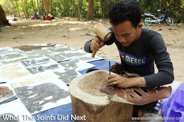 This young Cambodian man was making intricate souvenirs from leather hide, cutting the shapes and decorating by punching out holes. There were loads of sounvenir sellers near this particular temple, however, they didn't seem too pleased as the tourists were all drawn to the work by this artist who made plenty of sales. International Artist Day 2016.