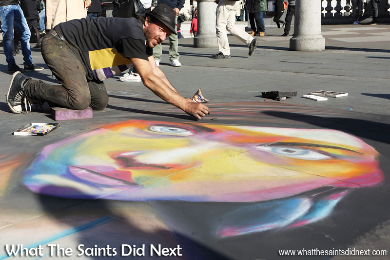 Street art in Trafalgar Square, London. This was more short term art, designed for entertainment and to tempt donations from passing tourists, which worked because the work was so stunning. There's something mesmerising about watching an image like this being created right before your eyes with coloured chalks. International Artist Day 2016.
