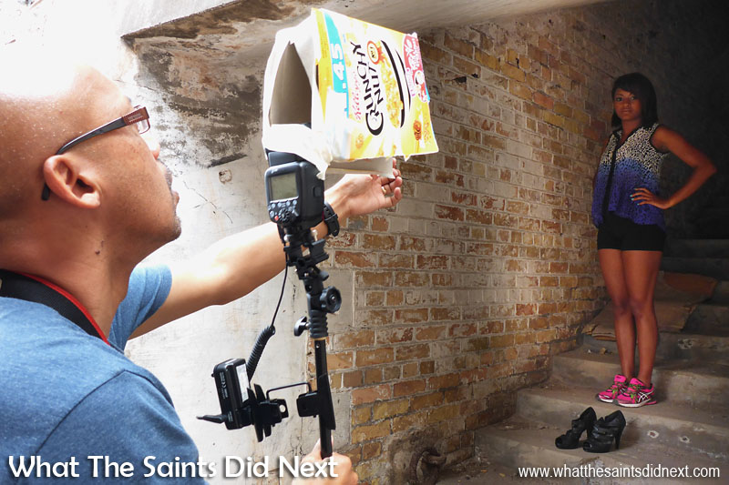 Behind the scenes on the Breeze e-magazine photoshoot. Setting up for the stairwell shoot using cereal boxes for gobos. A roll of masking tape and a cereal box makes a very cheap modifier which can be shaped and adjusted very quickly. Note, Emma is keeping her comfortable shoes on until the very last minute!  St Helena Breeze Photoshoot.
