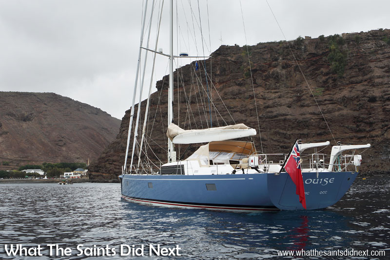 The beautiful yacht 'Louise' visiting St Helena Island, moored off Jamestown. Unfortunately sunshine was in short supply for Morgan and Cheryl's visit.  Girl Meets Boy And Sails Off Into The Sunset To Travel The World.