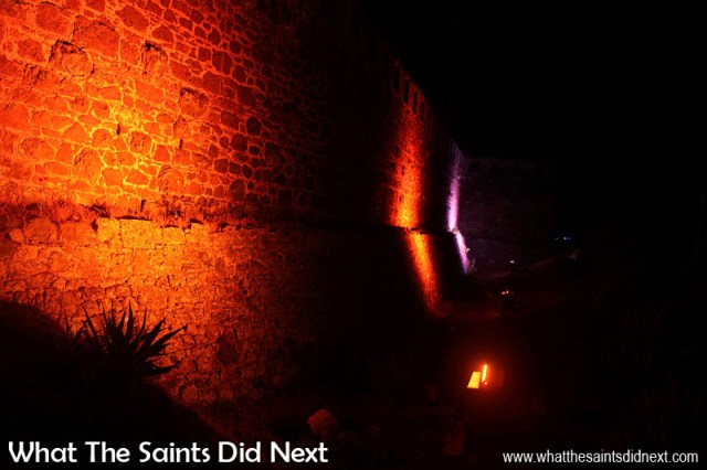 The lights automatically change colours as they shine up onto the old stone walls. High Knoll Fort lights, St Helena.