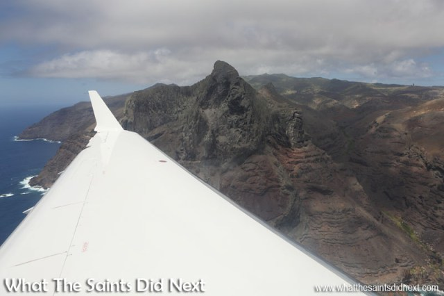 Minute 10 - Flying past Great Stone Top, wheels are down, now on final approach to Runway 02. The green grass down in the bottom of the valley to the right is Sharks Valley. Flying from St Helena Airport.