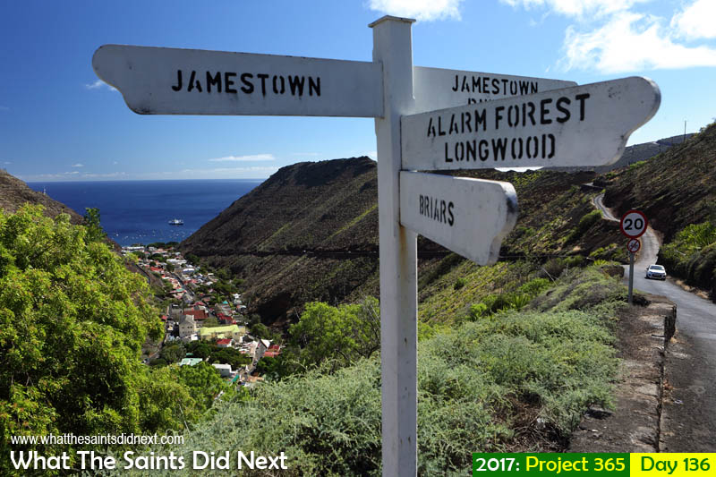 Sign post at Briars junction overlooking Jamestown, St Helena. RMS St Helena in port.