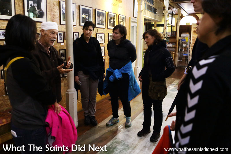 District Six Museum founder, Noor Ebraheim is also a former resident and evictee. Now a tour guide, he's seen here telling our group what it was like in 1966.