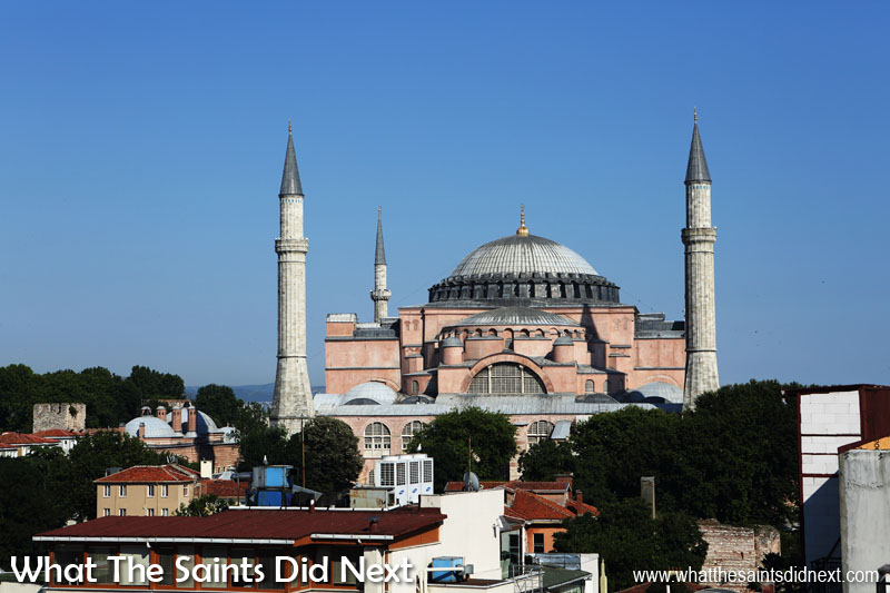 "The <a href=""http://whatthesaintsdidnext.com/2017/09/19/visiting-hagia-sophia-museum-istanbul-turkey/"" target=""_blank"" rel=""noopener"">Hagia Sophia</a> museum is one of the places the Arabic Ezan in Istanbul is broadcast from. The view of this spectacular building is from our hotel room."