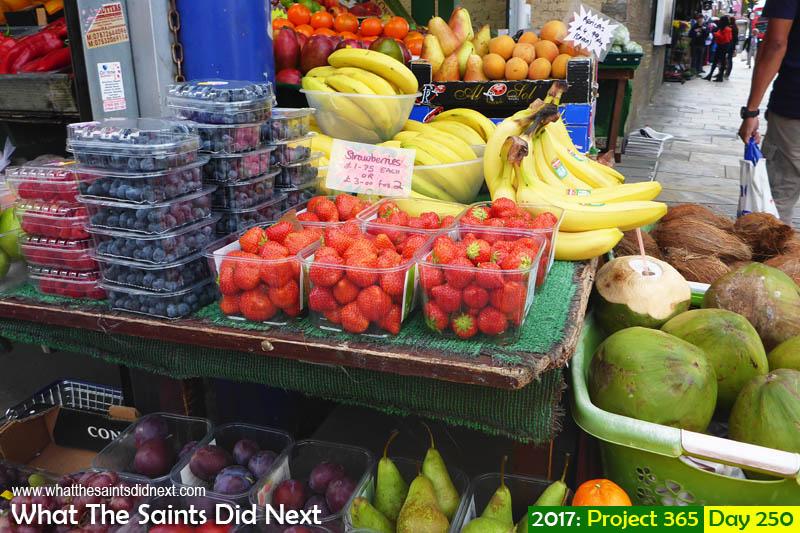 'Schoolboy stuff'<br /> 7 September, 2017, 15:39 - 1/200, f3.3, ISO-100 - Lumix DMC-FT5<br /> Fruit stall in Shepherd's Bush Market, London.