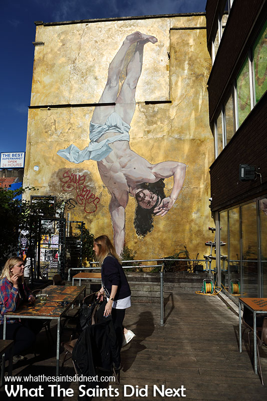 Breakdancing Jesus by artist Cosmo Sarson. Commissioned work by The Canteen diner. A kilo of gold glitter was used on this 28ft high mural.