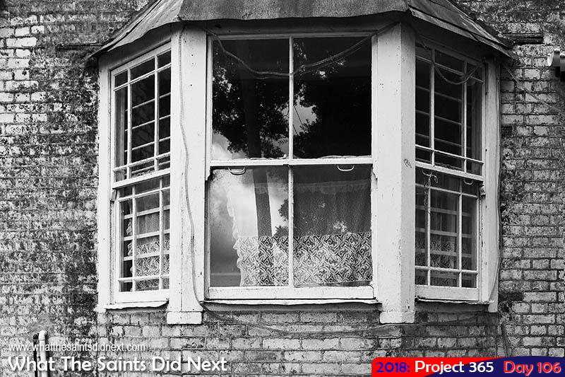 Kingshurst window in black and white.