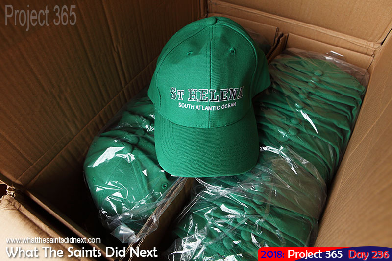 Opening new stock of souvenir baseball caps.