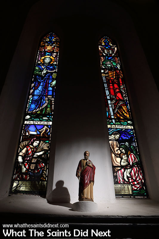 Stained glass windows, St Peter (left) and St Paul.
