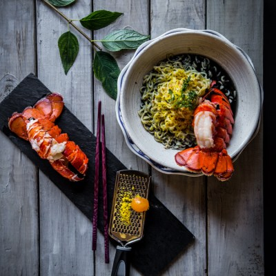 Ramen with broiled lobster tail in squid ink broth