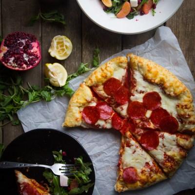 Super easy arugula pomegranate mozzarella salad