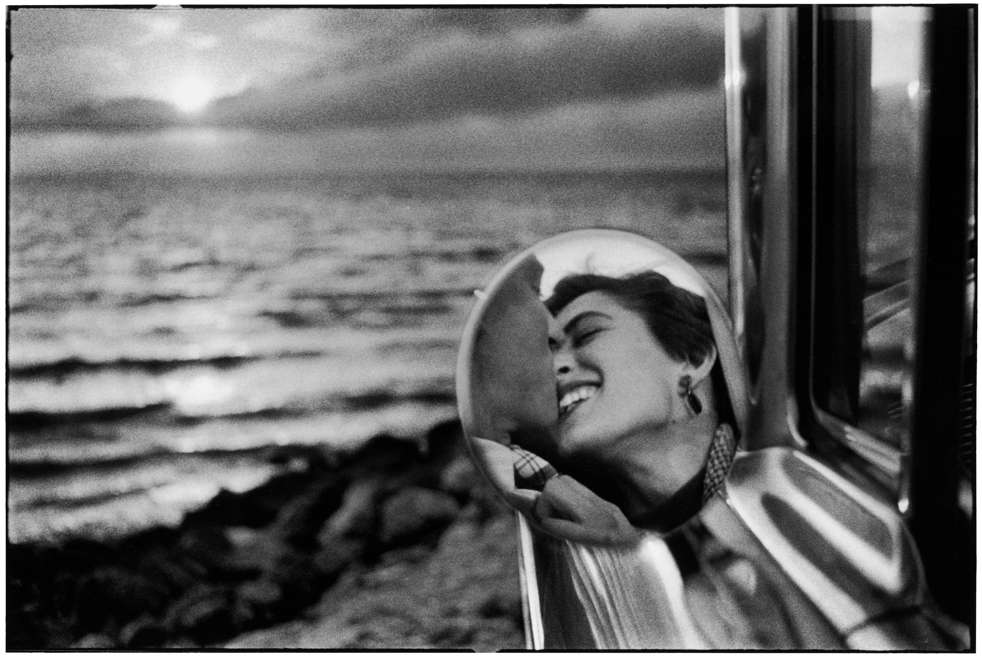"""Couple Kissing, California, 1955"" by Elliott Erwitt"