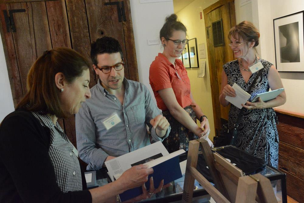 Photographers Matthew Gamber and Caitie Moore guided us through the small publishing house offerings on display at the Griffin Museum during NEPR 2014. (photo courtesy of Silke Hase)