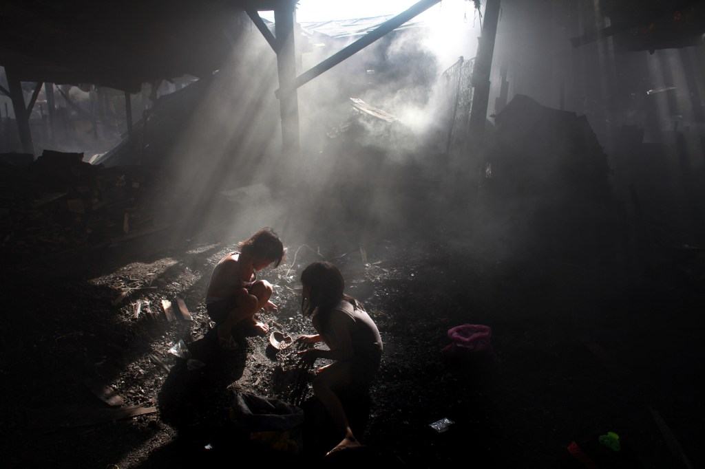 """Charcoal Kids of Ulingan (Charcoal Pits), Ulingan, Manila, 2008-2011"" archival pigment print on aluminum by Lisa Wiltse (courtesy of the artist and 555 Gallery, Boston)"