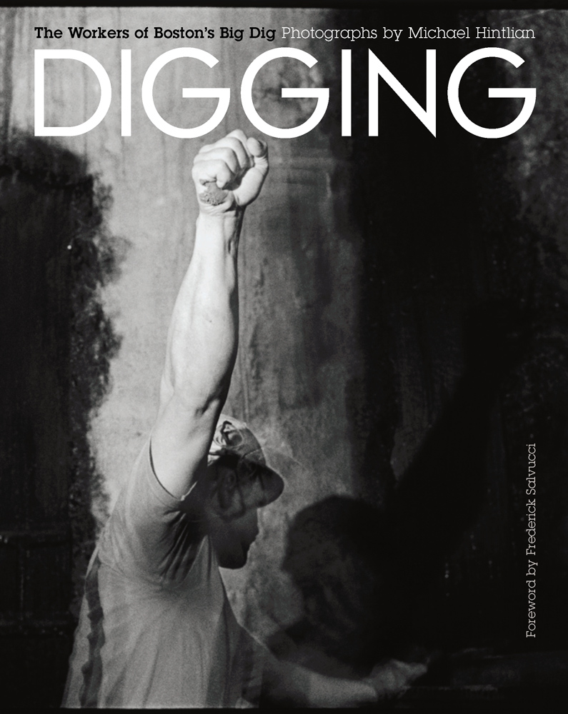 """""""Signaling a concrete truck under Causeway Street, 2000"""", book Jacket from Michael Hintlian's """"Digging: The Workers of Boston's Big Dig"""", now on view at C7A in Cambridge (courtesy of the artist)."""