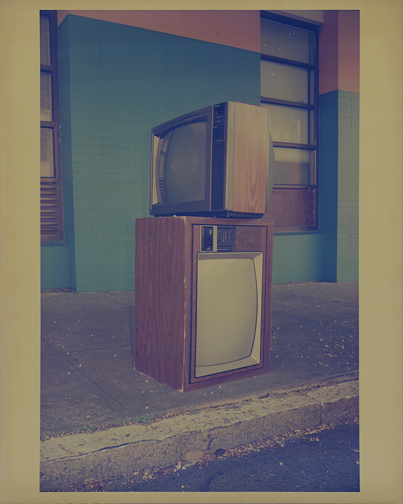 """""""Untitled (Stacked TVs), 2011"""" chromogenic print on expired paper from the series The After Life of Things by David Wolf (courtesy of the artist)."""