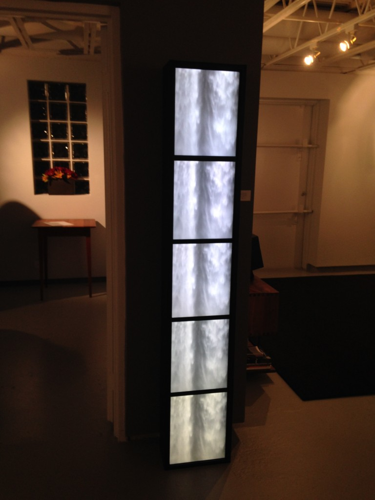 "Installation view of ""Waterfall Monolith, 2015"" video by Madeleine Altmann (courtesy of the artist and 555 Gallery, Boston)."
