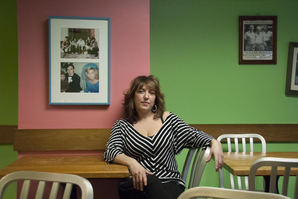 """""""Sheila Borges of the Neighborhood Restaurant and Bakery on Bow Street, owned by her family since 1983."""" photograph by Charan Devereaux (courtesy of the artist)."""