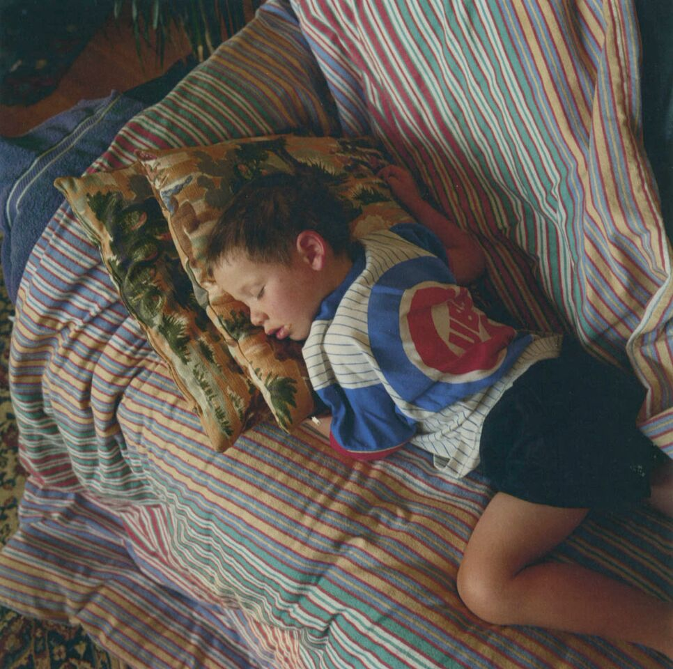 """Walker Asleep on the Couch, Boulder, Colorado, 1994"" in ""Notes From A Quiet Life"" by Robert Benjamin (Radius Books, 2012)."