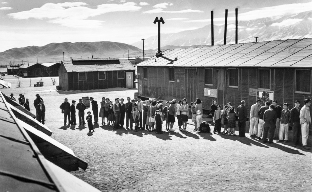 """Mess Line, Camp Manzanar, 1943"" by Ansel Adams (courtesy Addison Gallery of American Art, Andover, MA)."