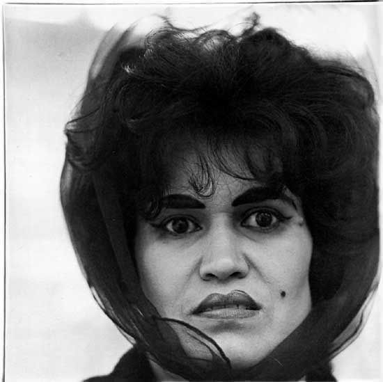 """Puerto Rican Woman with a Beauty Mark, NYC, 1965"" gelatin silver print by Diane Arbus, (courtesy of the J. Paul Getty Museum, Los Angeles)."