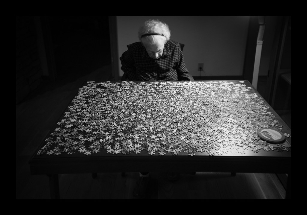old woman with puzzle