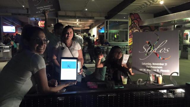 Members of the Isac Amaya Foundation http://isacamayafoundation.org during a first friday street art opening on their assigned table selling tickets for the Stylos Awards 2015 event https://stylosawards.yapsody.com/event/index/21478?ref=elink